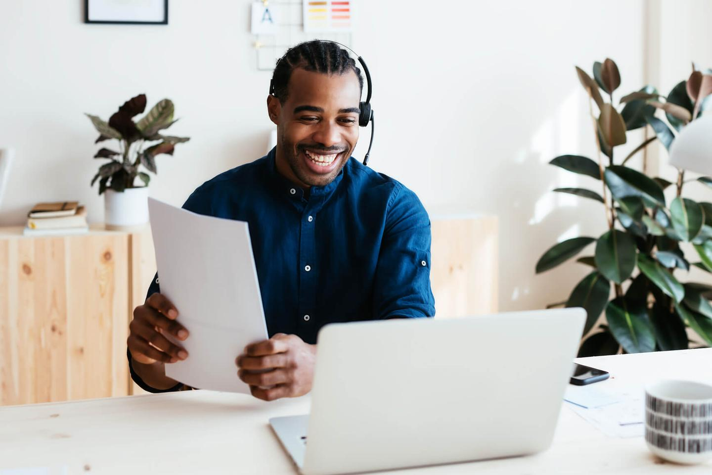Customer service agent smiling with laptop