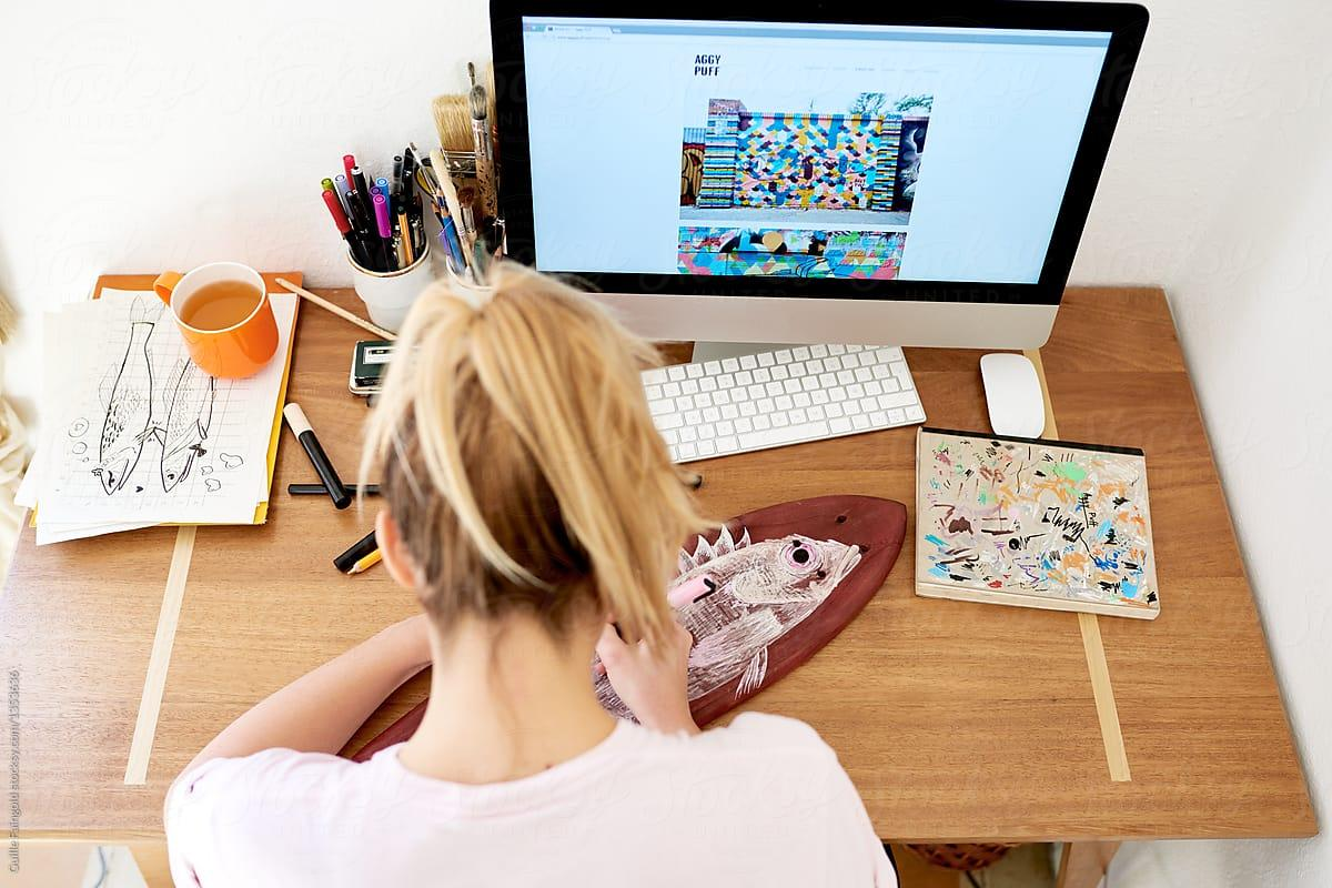 Woman designing designing a website to sell her artwork